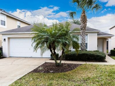Photo for Beautifully appointed new home with south facing pool/jaccuzi is only 3 miles from Disney.