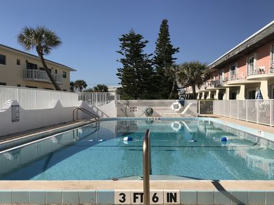 Photo for Dog-friendly, ocean view condo w/ a full kitchen, shared pool, & free WiFi