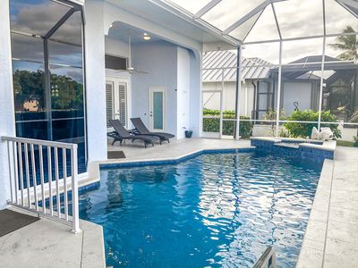 Photo for WELCOME 2 PARADISE, MARCO ISLAND POOL HOME, DOCK, ON WIDE CANAL, BOAT FRIENDLY!