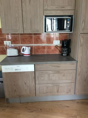 Kitchen equipped w/ microwave, stove, dishwasher, washer/dryer, coffeemaker