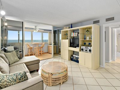 Photo for Beautiful 2 bedroom oceanfront condo with outdoor pool and WiFi access located uptown and just steps to the beach!