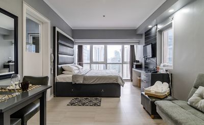Photo for 5 Star Hotel Like Condo w/ King Bed, BGC , 49SQM , Makati Skyline and Pool View