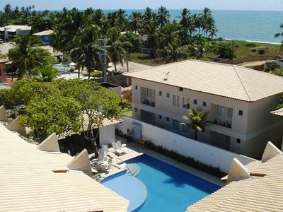Photo for Beautiful village, 4 bedrooms, 3 suites, 2 balconies, swimming pool, 100m from the beach