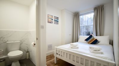 Photo for 1 bedroom flat with private garden in Kensington