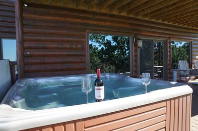 private outdoor hot tub on patio is crystal clear, inviting, romantic