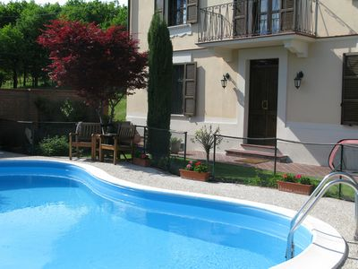 Photo for Stylish holiday home, beautiful setting, family friendly, gated pool, private.
