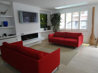 Living room with working log effect gas fire