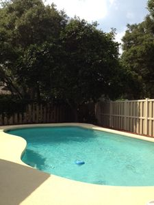 Private Pool in back yard. Professionally maintained. Pool deck & screened porch