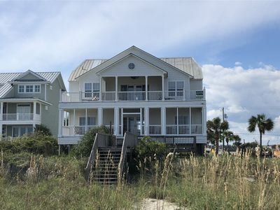Set back for privacy but waterfront with direct beach access