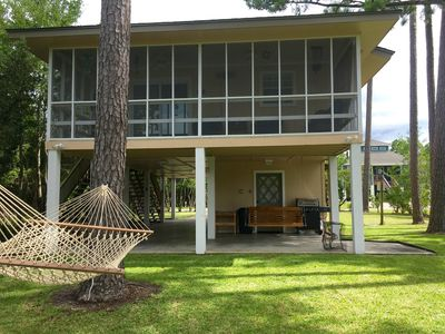 Lovely screened in porch overlooking bayou