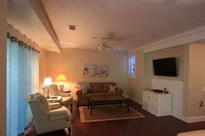 Living area featuring large flat screen television and comfortable seating.