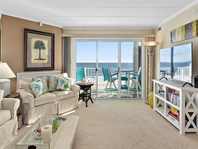 Photo for Luxury 3-bedroom oceanfront condo with outdoor pool, free WiFi, and immaculate decor located midtown and mere steps from the beach!