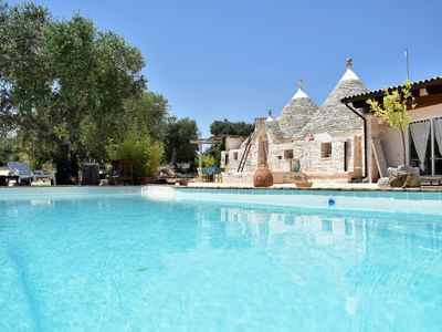 Photo for Paradise Trulli, with private HEATED pool, solarium, aircon, WiFi, barbecue