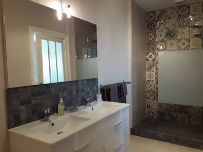 Double basins and a large walk-in shower.