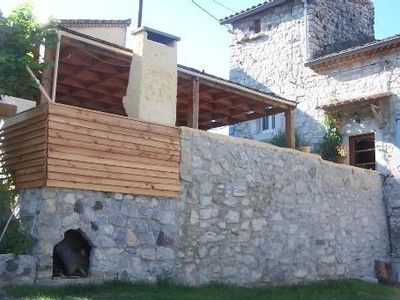 Photo for Stone house with pool in the heart of a village of character