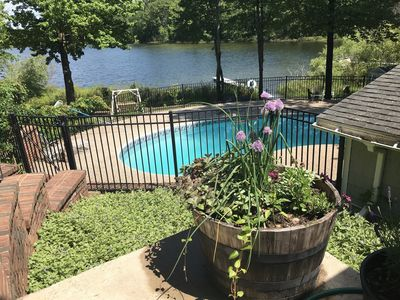 Photo for Roomy, waterfront home with outdoor pool. Pet friendly.