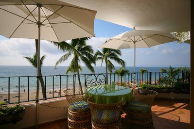 Oceanfront patio with umbrellas - the best seats in town