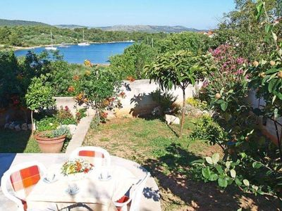 Photo for Two bedroom apartment with terrace and sea view Bilice, Krka (A-16904-a)