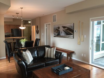 Photo for Two bedroom downtown lakefront condo with pools, hot tubs, tennis court, & gym!