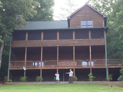 Lake side of the house, two porches with the main level screened in.