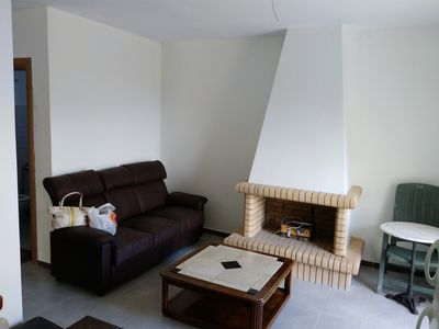 Photo for Hillside village getaway with panoramic sea views