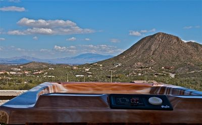 Sit in the hot tub and enjoy the Tucson Valley below