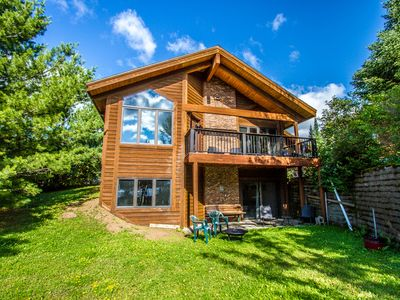 Photo for Large modern home on the shores of Devil Track Lake - perfect for the family