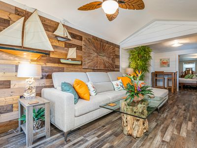 Photo for Newly Renovated in 2019 - Perfect Couples Retreat. Less than 100 yards to the beach!