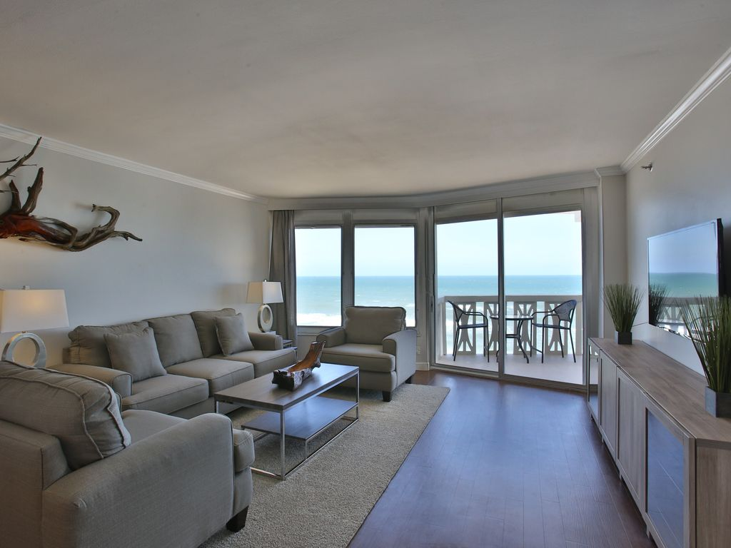 With modern furniture, the living room is comfortable and opens to the  balcony.