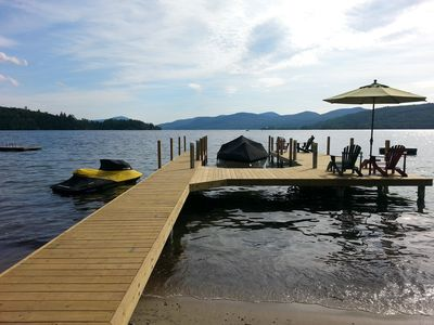 Dock with plenty of seating room, space for 4 boats and sandy beach