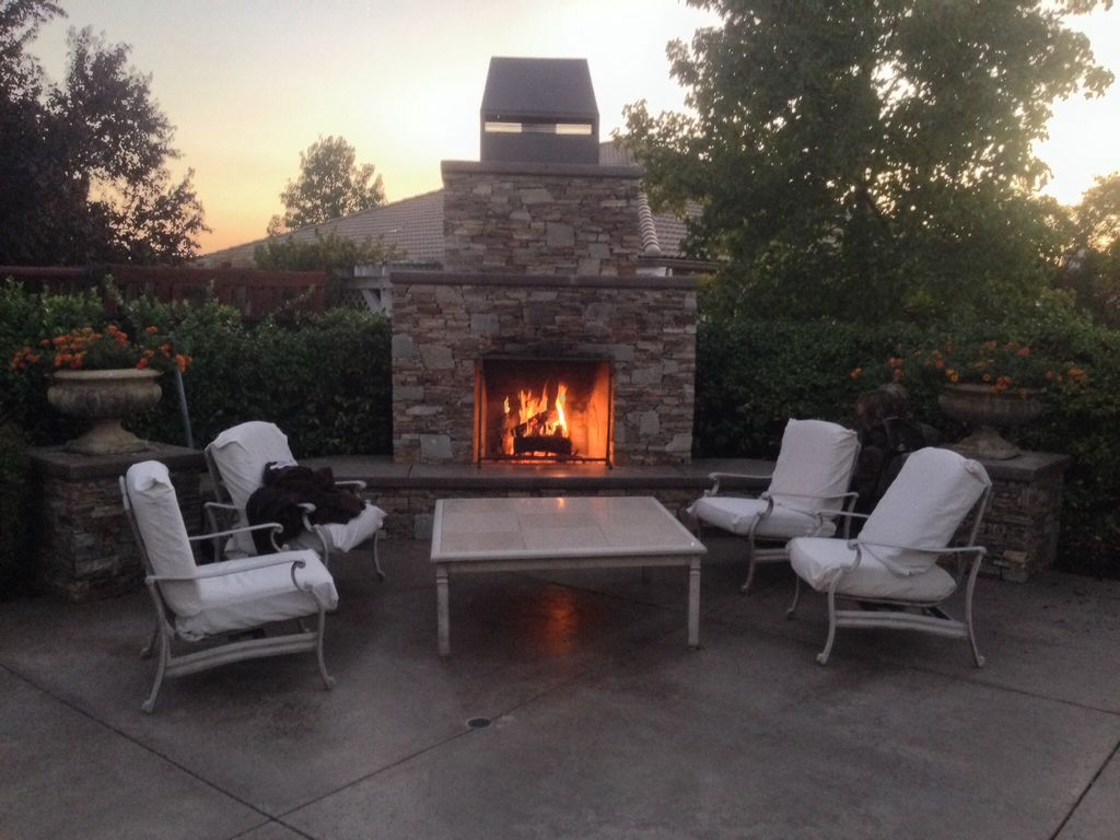 luxury living sparkling pool waterfalls outdoor fireplace