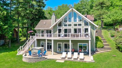 Photo for Stunning lake views, private dock & walking distance to Chairlift #5!