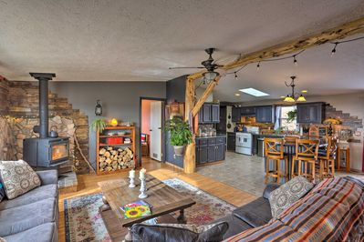 Rustic comfort and modern amenities await at this 3-BR, 3-bath Hot Springs home!