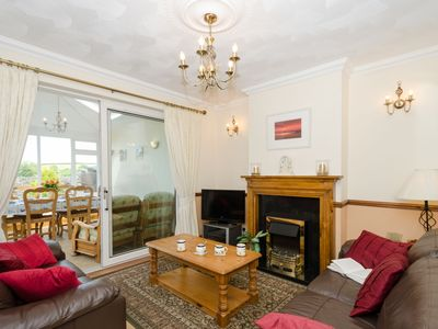 Photo for Delightful cottage only a mile from the sea