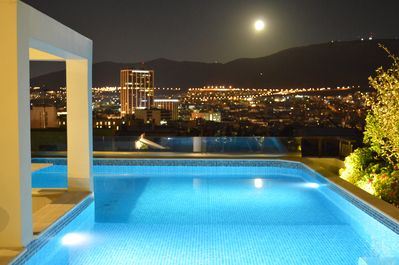 Private swimming pool at roof garden with panoramic city view