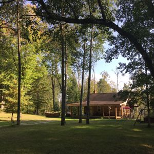 Log Cabin with private river frontage on blue-ribbon trout stream!