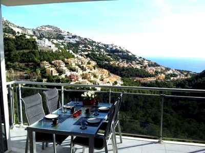 Photo for Overlooking the sea and the lighted Altea hills, 4 person apartment.