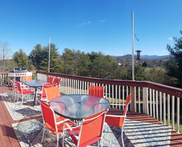 Enjoy warm, sunny wrap around deck and view lovely distant snow cap mountains.