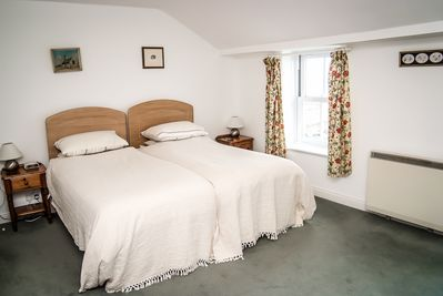 Spacious galleried bedroom, with twin beds
