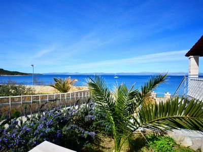 Photo for Fantastic holiday apartment on the seafront with large terrace