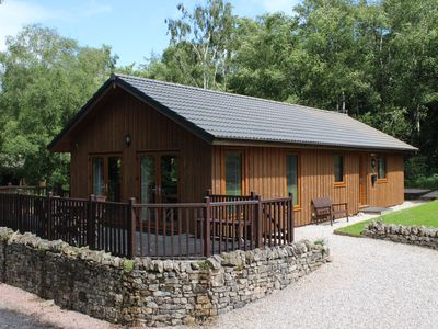Photo for Beautiful timber lodge, nestled in tranquil wildlife haven with mountain views.