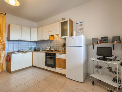 Photo for Lovely Comfortable Apartment 100m from wide sandy beach.