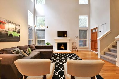 Living Room - The living room is full of natural light, thanks to its floor-to-high-ceiling windows.