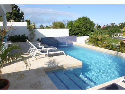 Photo for Beautiful Designer Private Pool & Gardens Walk to Town.