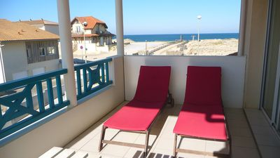 Photo for MIMIZAN beach Apartment 50 m from the beach. Large terrace ocean view. WIRELESS