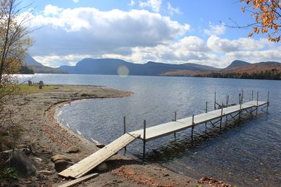 private dock with and sandy, shallow water access