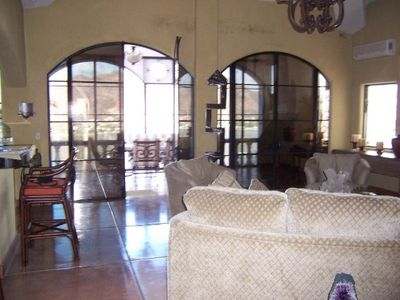 Living Room looking out to sun room and San Carlos Bay, mountains& Sea of Cortez