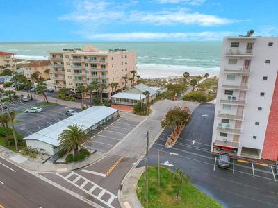 Photo for Recently updated, beachside apartment w/ a full kitchen - steps to the beach!