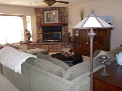 FAMILY ROOM WITH FIREPLACE OPEN TO THE KITCHEN AND DINING ROOM