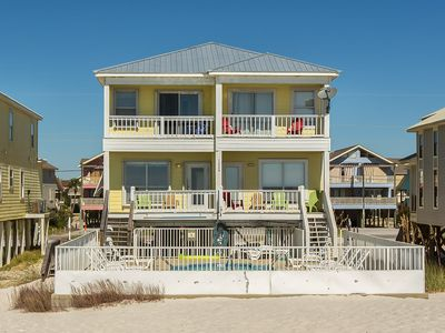 Photo for The Beach is Calling! 5 Bedroom 3 Bath House only footsteps from white sands.
